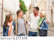 Купить «group of smiling friends walking in the city», фото № 6217018, снято 14 июня 2014 г. (c) Syda Productions / Фотобанк Лори