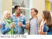 Купить «group of smiling friends with take away coffee», фото № 6217102, снято 14 июня 2014 г. (c) Syda Productions / Фотобанк Лори