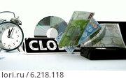 Купить «Euro notes falling beside video tape alarm clock and closed sign», видеоролик № 6218118, снято 17 января 2019 г. (c) Wavebreak Media / Фотобанк Лори