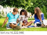 Купить «Group of multi ethnic students in a city park», фото № 6222946, снято 2 июня 2014 г. (c) Andrejs Pidjass / Фотобанк Лори
