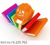 Купить «Защитная каска на разноцветных книгах, изолированно на белом фоне», иллюстрация № 6225762 (c) Guru3d / Фотобанк Лори