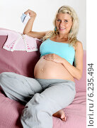 Купить «Pregnant woman spending free time.», фото № 6235494, снято 12 июля 2020 г. (c) BE&W Photo / Фотобанк Лори