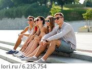Купить «group of smiling friends sitting on city square», фото № 6235754, снято 20 июля 2014 г. (c) Syda Productions / Фотобанк Лори