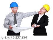 Купить «Engineer jealous of his colleague», фото № 6237254, снято 29 марта 2011 г. (c) Phovoir Images / Фотобанк Лори
