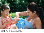 Купить «Mother with daughter in the garden.», фото № 6238502, снято 22 мая 2018 г. (c) BE&W Photo / Фотобанк Лори