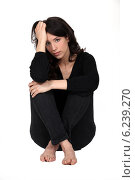 Купить «Woman sitting pensively», фото № 6239270, снято 21 марта 2011 г. (c) Phovoir Images / Фотобанк Лори
