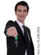 Купить «Estate-agent dangling keys», фото № 6240054, снято 5 апреля 2011 г. (c) Phovoir Images / Фотобанк Лори