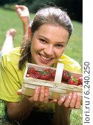 Купить «Girl eating strawberries on the meadow in the summer», фото № 6240250, снято 14 декабря 2018 г. (c) BE&W Photo / Фотобанк Лори
