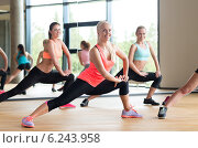 Купить «group of women working out in gym», фото № 6243958, снято 7 июня 2014 г. (c) Syda Productions / Фотобанк Лори