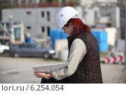 Купить «Female site surveyor», фото № 6254054, снято 29 октября 2009 г. (c) Phovoir Images / Фотобанк Лори