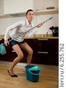 Купить «Young woman while doing housework», фото № 6255762, снято 18 февраля 2019 г. (c) BE&W Photo / Фотобанк Лори