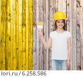Купить «smiling little girl in helmet with paint brush», фото № 6258586, снято 30 апреля 2014 г. (c) Syda Productions / Фотобанк Лори
