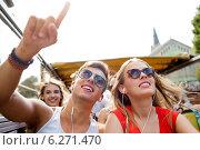 Купить «smiling couple with earphones traveling by bus», фото № 6271470, снято 20 июля 2014 г. (c) Syda Productions / Фотобанк Лори