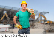 smiling manual worker in helmet with wooden boards. Стоковое фото, фотограф Syda Productions / Фотобанк Лори