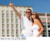 Купить «smiling couple in city», фото № 6276986, снято 23 июля 2014 г. (c) Syda Productions / Фотобанк Лори