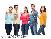 Купить «group of smiling teenagers showing triumph gesture», фото № 6277026, снято 22 июня 2014 г. (c) Syda Productions / Фотобанк Лори