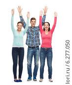 Купить «group of smiling teenagers with raised hands», фото № 6277050, снято 22 июня 2014 г. (c) Syda Productions / Фотобанк Лори