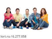 Купить «group of smiling teenagers showing thumbs up», фото № 6277058, снято 22 июня 2014 г. (c) Syda Productions / Фотобанк Лори