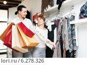 Купить «Couple choosing clothes at store», фото № 6278326, снято 22 февраля 2014 г. (c) Яков Филимонов / Фотобанк Лори