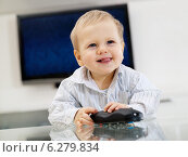 Купить «Baby boy playing with remote control», фото № 6279834, снято 18 ноября 2019 г. (c) BE&W Photo / Фотобанк Лори