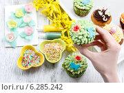 Купить «Woman decorates easter cupcakes. Festive and party dessert», фото № 6285242, снято 29 февраля 2020 г. (c) BE&W Photo / Фотобанк Лори