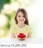 Купить «beautiful little girl sitting at table», фото № 6285350, снято 30 апреля 2014 г. (c) Syda Productions / Фотобанк Лори