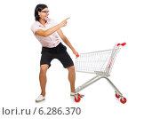 Купить «Man shopping with supermarket basket cart isolated on white», фото № 6286370, снято 2 июня 2014 г. (c) Elnur / Фотобанк Лори