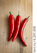 Купить «Red hot chili peppers on old wooden table. Healthy food», фото № 6291658, снято 23 января 2020 г. (c) BE&W Photo / Фотобанк Лори