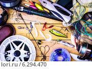 Рыболовные снасти на столе. Стоковое фото, фотограф Дмитрий Бодяев / Фотобанк Лори