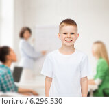 Купить «smiling little boy in white blank t-shirt», фото № 6296530, снято 3 июня 2014 г. (c) Syda Productions / Фотобанк Лори