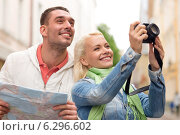 Купить «smiling couple with map and photocamera in city», фото № 6296602, снято 14 июня 2014 г. (c) Syda Productions / Фотобанк Лори