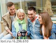 Купить «group of smiling friends with digital photocamera», фото № 6296610, снято 14 июня 2014 г. (c) Syda Productions / Фотобанк Лори