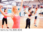 Купить «group of people working out with barbells in gym», фото № 6300434, снято 28 сентября 2013 г. (c) Syda Productions / Фотобанк Лори
