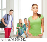 Купить «smiling young woman in blank green t-shirt», фото № 6300542, снято 1 июня 2013 г. (c) Syda Productions / Фотобанк Лори