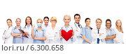 Купить «smiling doctors and nurses with red heart», фото № 6300658, снято 18 мая 2013 г. (c) Syda Productions / Фотобанк Лори