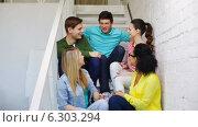 Купить «Smiling students sitting on stairs and talking», видеоролик № 6303294, снято 15 апреля 2014 г. (c) Syda Productions / Фотобанк Лори