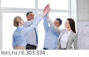 Купить «Business team doing high five gesture in office», видеоролик № 6303334, снято 16 апреля 2014 г. (c) Syda Productions / Фотобанк Лори