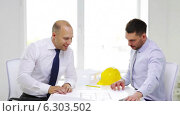 Купить «Two smiling businessmen or architects in office», видеоролик № 6303502, снято 11 июня 2014 г. (c) Syda Productions / Фотобанк Лори