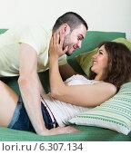 Купить «Adult couple on sofa in home», фото № 6307134, снято 4 июня 2014 г. (c) Яков Филимонов / Фотобанк Лори