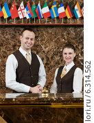 Купить «Hotel workers on reception», фото № 6314562, снято 22 апреля 2014 г. (c) Дмитрий Калиновский / Фотобанк Лори