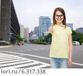 Купить «smiling cute little girl in black eyeglasses», фото № 6317338, снято 30 апреля 2014 г. (c) Syda Productions / Фотобанк Лори