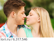 Купить «smiling couple touching noses in park», фото № 6317546, снято 7 июля 2014 г. (c) Syda Productions / Фотобанк Лори