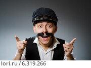 Купить «Funny taxi driver wearing peaked cap», фото № 6319266, снято 16 июня 2014 г. (c) Elnur / Фотобанк Лори