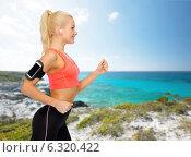 Купить «sporty woman running with smartphone and earphones», фото № 6320422, снято 8 мая 2014 г. (c) Syda Productions / Фотобанк Лори