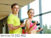 Купить «smiling man and woman with dumbbells in gym», фото № 6332402, снято 29 июня 2014 г. (c) Syda Productions / Фотобанк Лори