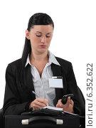Купить «Reporter wearing visitors badge», фото № 6352622, снято 4 мая 2011 г. (c) Phovoir Images / Фотобанк Лори