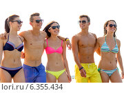 Купить «smiling friends in sunglasses on summer beach», фото № 6355434, снято 3 августа 2014 г. (c) Syda Productions / Фотобанк Лори