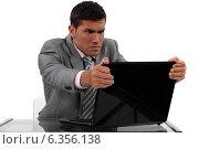 Купить «Businessman alarmed at his laptop», фото № 6356138, снято 31 мая 2011 г. (c) Phovoir Images / Фотобанк Лори