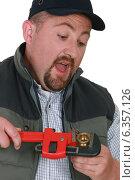 Купить «Plumber tightening nut with adjustable wrench», фото № 6357126, снято 10 июня 2011 г. (c) Phovoir Images / Фотобанк Лори
