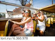 Купить «group of smiling friends traveling by tour bus», фото № 6360978, снято 20 июля 2014 г. (c) Syda Productions / Фотобанк Лори